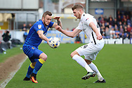 AFC Wimbledon midfielder Dean Parrett (18) battles for possession with Northampton Town forward Michael Smith (24) during the EFL Sky Bet League 1 match between AFC Wimbledon and Northampton Town at the Cherry Red Records Stadium, Kingston, England on 11 March 2017. Photo by Matthew Redman.