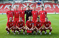 WREXHAM, WALES - Saturday, October 10, 2009: Wales' players line-up for a team group photograph before the UEFA Under-21 Championship Qualifying Round Group 3 match against Bosnia-Herzegovina at the Racecourse Ground. Back row L-R: Aaron Morris, Christian Ribeiro, Nathan Craig, goalkeeper Chris Maxwell, Marc Williams, Ched Evans. Front row L-R: Ashley Richards, Andy King, captain Shaun MacDonald, Neil Taylor and Darcy Blake. (Pic by Chris Brunskill/Propaganda)