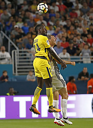 Paris Saint-Germain midfielder Blaise Matuidi (14) jumps for the ball with Juventus defender Stephan Lichtsteiner (26) during the first half of an International Champions Cup match on Wednesday, July 26, 2017, at Hard Rock Stadium in Miami Gardens, Fla. Juventus won, 3-2. Photo by David Santiago/El Nuevo Herald/TNS/ABACAPRESS.COM