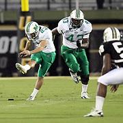 Marshall kicker Justin Haig (23) kicks off during an NCAA football game between the Marshall Thundering Herd and the Central Florida Knights at Bright House Networks Stadium on Saturday, October 8, 2011 in Orlando, Florida. (Photo/Alex Menendez)