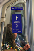 A social distancing sign on a Jubilee line train in London on Sept 12, 2020. The Government enforced a new law which makes it mandatory to wear protective face masks on all public transport to help stop the transmission of COVID-19 in the UK.<br /> The British government's scientific advisory board announced on Friday that the reproduction number of coronavirus transmission across the UK was now over 1.0. The Science and the Scientific Advisory Group for Emergencies (SAGE) said the R-value was now between 1.0 and 1.2. (VXP Photo/ Vudi Xhymshiti)