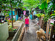20 MAY 2017 - BANGKOK, THAILAND:  A boy who lives in Pom Mahakan walks through the old fort. The final evictions of the remaining families in Pom Mahakan, a slum community in a 19th century fort in Bangkok, have started. City officials are moving the residents out of the fort. NGOs and historic preservation organizations protested the city's action but city officials did not relent and started evicting the remaining families in early March.       PHOTO BY JACK KURTZ