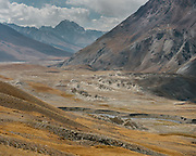 """View over the Afghan Pamir mountains. From Aqbelis pass to Baiqara, a Wakhi high pasture. Guiding and photographing Paul Salopek while trekking with 2 donkeys across the """"Roof of the World"""", through the Afghan Pamir and Hindukush mountains, into Pakistan and the Karakoram mountains of the Greater Western Himalaya."""
