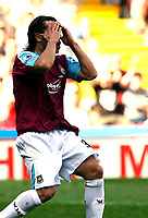 Photo: Paul Greenwood.<br />Sheffield United v West Ham United. The Barclays Premiership. 14/04/2007.<br />West Ham's Carlos Tevez reacts after missing an easy chance