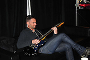 Adam Levine, lead singer for Maroon 5 warms up in his dressing room before Maroon 5 takes the stage to play the DirectTV Celebrity Flag Football event in Dallas DirectTv Celebrity Beach Bowl in Dallas Texas Saturday 5,2011.  Eli  Manning coached on team with Josh Duhamel, Marisa Miller and Alex Rodriguez coached the other team.Photo©SuziAltman