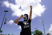 09 SEPTEMBER 2003 - CANCUN, QUINTANA ROO, MEXICO: An anti-globalization protestor takes a picture of other anti-globalization protestors as they march through Cancun, Mexico during the World Trade Organization Ministerial meetings in Cancun. A few thousand people participated in the march, which was stopped by Mexican law enforcement at the edge of the city of Cancun, several miles from the WTO meeting site at the Cancun Convention Center. Up to 20,000 anti-globalization protestors are expected in Cancun for the WTO ministerial meetings.  PHOTO BY JACK KURTZ
