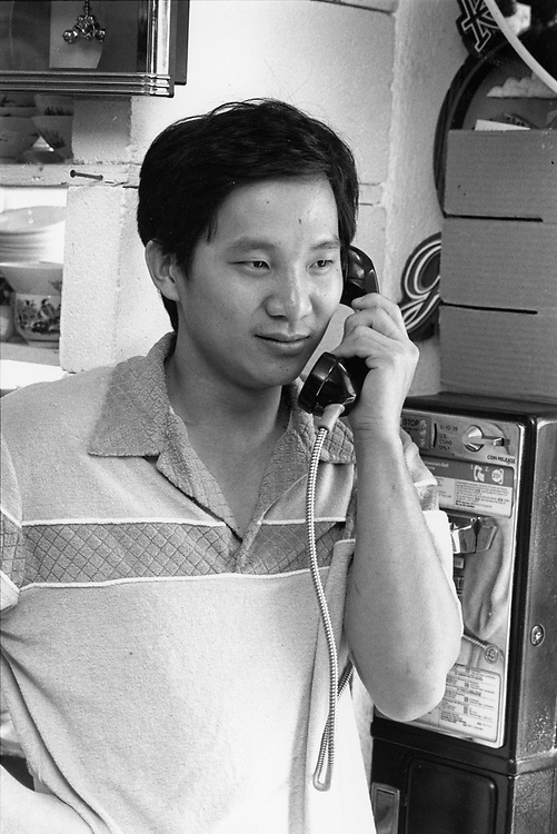 ©1993 Asian-American shopkeeper on the pay phone, MR EP-0091