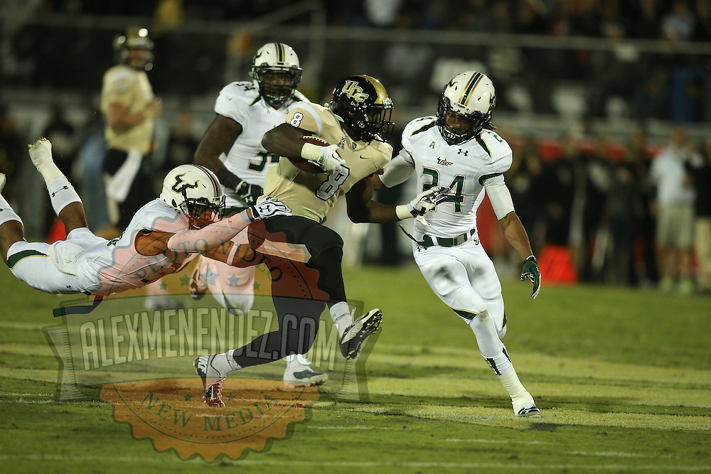 UCF Knights running back Storm Johnson (8) runs the ball during an NCAA football game between the South Florida Bulls and the 17th ranked University of Central Florida Knights at Bright House Networks Stadium on Friday, November 29, 2013 in Orlando, Florida. (AP Photo/Alex Menendez)