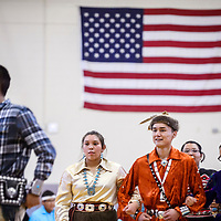 Megan Watchman and William Ellison perform a skip dance with other Gallup High School students during the Gallup McKinley County Schools Navajo Language and Culture Day at Miyamura High School Tuesday.