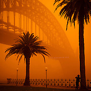 Man Photographing the Sydney Harbour Bridge during dust storm, September 23, 2009. The Dust storm was caused by gale force winds blowing in from the drought stricken inland. The storm was described as being the worst in 70 years.<br />