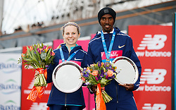 Winner of the men's race Mo Farah, (right) alongside the winner of the women's race Charlotte Purdue, (left) during the Vitality Big Half in London City Centre.
