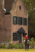 A mounted Fox Hunter waits for the start of the hunt in front of the plantation house at Middleton Place plantation in Charleston, SC.