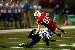 26 September 2009: Ben Graves flies horizontally over General Parnell as Parnell throws an open field block. South Dakota State Jackrabitts jump past the Illinois State Redbirds 38 - 17 at Hancock Stadium on campus of Illinois State University in Normal Illinois
