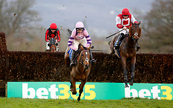 Kelvingrove and Killian Moore (right) trail Silent Steps and Harry Cobden over the last fence before going on to win The Dave Criddle Travel & Bristol Airport Steeple Chase Race run at Taunton Racecourse.