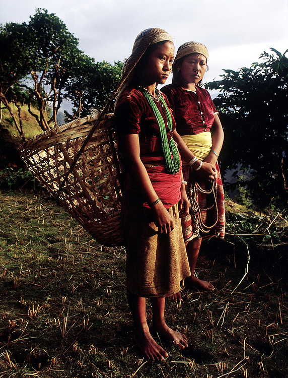 Gurkha women on their way to work in the fields in Nepal. 1969. Photographed by Terry Fincher.