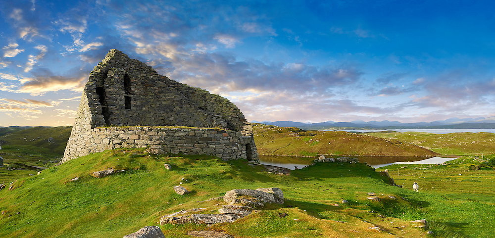 Pictures of Dun Carloway Broch on the Isle of Lewis in the Outer Hebrides, Scotland. Brochs are among Scotland's most impressive prehistoric buildings and were the precursors of the Medieval Scottish Tower Houses. The world Broch is derived from lowland scots who called forts Brough from the old Norse Borg. <br /> <br /> Broch stone roundhouses date from about 2,300 to 1,900 years ago, and are found mainly in north and west Scotland. Dun Carloway Broch was probably built around the time of the Roman occupation in Britain in 43AD and was probably the primary dwelling-places for the principal family in the area. Dun Carloway Broch would have provided some protection against sporadic raiding, but were not purely defensive structure but a focal point for the clan of the area. .<br /> <br /> Visit our SCOTLAND HISTORIC PLACXES PHOTO COLLECTIONS for more photos to download or buy as wall art prints https://funkystock.photoshelter.com/gallery-collection/Images-of-Scotland-Scotish-Historic-Places-Pictures-Photos/C0000eJg00xiv_iQ<br /> '<br /> Visit our PREHISTORIC PLACES PHOTO COLLECTIONS for more  photos to download or buy as prints https://funkystock.photoshelter.com/gallery-collection/Prehistoric-Neolithic-Sites-Art-Artefacts-Pictures-Photos/C0000tfxw63zrUT4