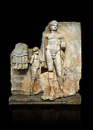 Roman Sebasteion relief  sculpture of Emperor Nero with captive, Aphrodisias Museum, Aphrodisias, Turkey.   Against a black background.<br /> <br /> Naked warrior emperor Nero holds the orb of world rule in one hand and crowns the military trophy with the other. Between the trophy and the emperor stands a bound captive boy. He wears long barbarian trousers and looks up at Nero. .<br /> <br /> If you prefer to buy from our ALAMY STOCK LIBRARY page at https://www.alamy.com/portfolio/paul-williams-funkystock/greco-roman-sculptures.html . Type -    Aphrodisias     - into LOWER SEARCH WITHIN GALLERY box - Refine search by adding a subject, place, background colour, museum etc.<br /> <br /> Visit our ROMAN WORLD PHOTO COLLECTIONS for more photos to download or buy as wall art prints https://funkystock.photoshelter.com/gallery-collection/The-Romans-Art-Artefacts-Antiquities-Historic-Sites-Pictures-Images/C0000r2uLJJo9_s0