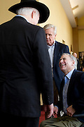 Texas Attorney General Greg Abbott speaks with U.S. Senator John Cornyn during the Texas State Rifle Association convention on Saturday, February 23, 2013 in Mesquite, Texas. (Cooper Neill/The Dallas Morning News)