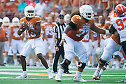 AUSTIN, TX - SEPTEMBER 26:  Jerrod Heard #13 of the Texas Longhorns drops back to pass against the Oklahoma State Cowboys during the 2nd quarter on September 26, 2015 at Darrell K Royal-Texas Memorial Stadium in Austin, Texas.  (Photo by Cooper Neill/Getty Images) *** Local Caption *** Jerrod Heard