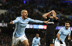 Manchester City's David Silva celebrates scoring his side's second goal of the game during the Premier League match at the Etihad Stadium, Manchester.