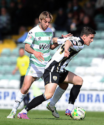 Jordan Williams of Notts County is tackled by Yeovil Town's Sam Foley- Photo mandatory by-line: Harry Trump/JMP - Mobile: 07966 386802 - 11/04/15 - SPORT - FOOTBALL - Sky Bet League One - Yeovil Town v Notts County - Huish Park, Yeovil, England.