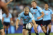Waratahs winger Drew Mitchell takes a quick penalty to cross for his first try. Super 14 Rugby Union, Waratahs v Lions, Sydney Football Stadium, Australia. Friday 12 March 2010. Photo: Clay Cross/PHOTOSPORT