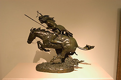 """WY: Wyoming, Cody: Buffalo Bill Historical Center...Whitney Museum of Western Art.  .Frederic Remington sculpture """"The Cheyenne"""".Photo #: yellow622..Photo copyright Lee Foster, 510/549-2202, lee@fostertravel.com, www.fostertravel.com.."""