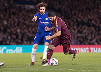 Football - 2017 / 2018 UEFA Champions League - Round of Sixteen, First Leg: Chelsea vs. Barcelona<br /> <br /> Luis Suarez (Barcelona) tries to break away from Cesc Fabregas (Chelsea FC)  at Stamford Bridge.<br /> <br /> COLORSPORT/DANIEL BEARHAM