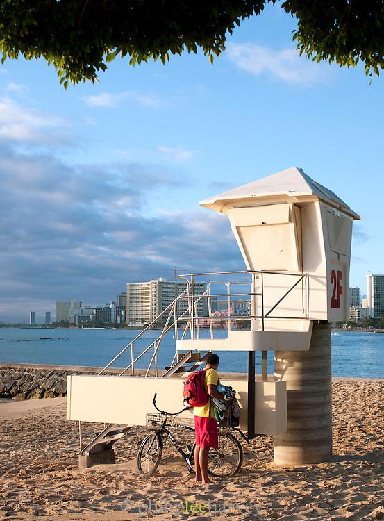 A lifeguard arriving at his station on Waikiki Beach, Honolulu, O'Ahu, Hawai?i
