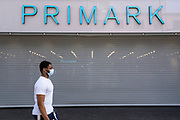 As the third national coronavirus lockdown continues in the city centre as the country enjoys the first days of the easing of lockdown restrictions, non essential shops such as Primark remain closed on 30th March 2021 in Birmingham, United Kingdom. After months of lockdown, the first signs that life will start to get back to normal begin, with more people enjoying the company of others in public, as the rule of six starts the first stage of lockdown ending.