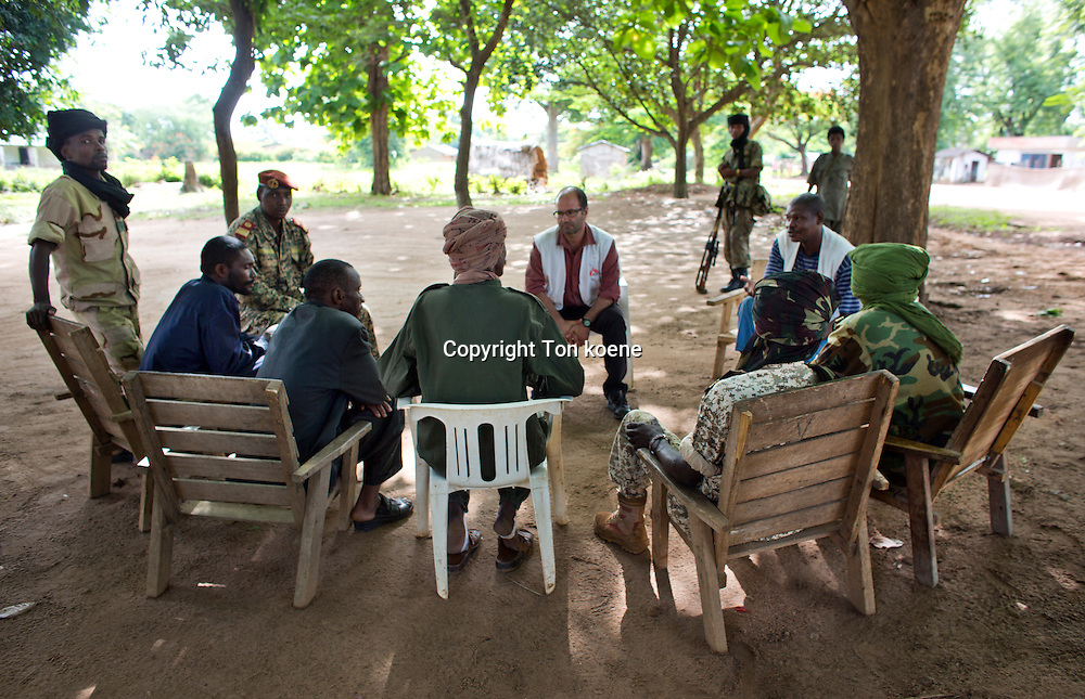 MSF project coord (carlos francisco) negotiating with rebel leaders in batangafo, central african republic