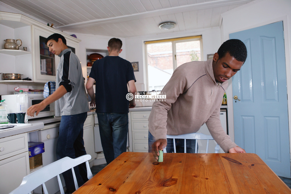 Youths cleaning the kitchen,