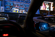 Seen from the driver's seat, British Soprano Nardus Williams plays Mimi in Puccini's La bohème, performed by English National Opera (ENO) as a drive-in (ENO Drive and Live) at Alexandra Palace, on 18th September 2020, in London, England. This is ENO's first public performance since the closure of their West End Colisseum home venue, because of the Coronavirus pandemic lockdown in March. This is Europe's first live drive-in opera production that audiences can safely experience from their cars and ENO's first public performance since the closure of their West End Colisseum home venue, because of the Coronavirus pandemic lockdown in March. As per the latest government advice. Each bubbled group consists of; 34 members of the<br /> ENO Orchestra, 20 ENO Chorus members and 8 principals. Each bubble has its own individual crew to oversee their rehearsals and performances.