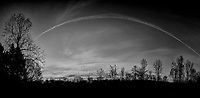 Backyard Autumn Clouds at Dawn. Composite of 11 images taken with a Nikon Df camera and 28 mm f/1.8 lens (ISO 100, 28 mm, f/1.8, 1/125 sec). Raw images processed with Capture One Pro, composite produced with AutoPano Giga Pro, and converted to B&W with Nik Silver Efex Pro