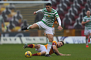 Tom Rogic (Celtic) skips past Stephen O'Donnell (Motherwell) during the Scottish Premiership match between Motherwell and Celtic at Fir Park, Motherwell, Scotland on 8 November 2020.