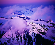 Aerial view of pink light from setting sun illuminating mountains near Chernof Glacier and Harding Icefield, Kenai Fjords National Park and Kenai National Wildlife Refuge, Alaska.
