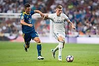 Real Madrid's player Toni Kroos and Celta de Vigo's player Nemanja Radoja during a match of La Liga Santander at Santiago Bernabeu Stadium in Madrid. August 27, Spain. 2016. (ALTERPHOTOS/BorjaB.Hojas)
