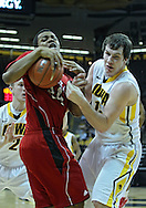 January 26, 2012: Nebraska Cornhuskers guard Dylan Talley (24) and Iowa Hawkeyes forward Aaron White (30) battle for the ball as Iowa Hawkeyes guard Josh Oglesby (2) looks on during the NCAA basketball game between the Nebraska Cornhuskers and the Iowa Hawkeyes at Carver-Hawkeye Arena in Iowa City, Iowa on Thursday, January 26, 2012.