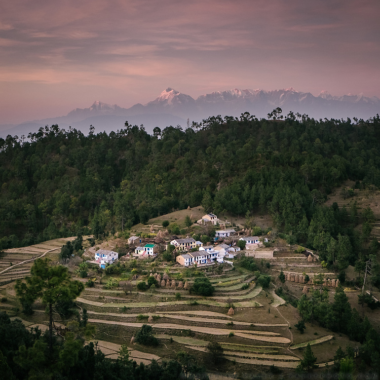 A village nestled below Nanda Devi (7,816 m / 25,643 ft), the highest mountain located entirely within the country. In the Himalaya.