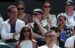 Chris Evans watches the action on centre court on day four of the Wimbledon Championships at The All England Lawn Tennis and Croquet Club, Wimbledon.