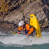 A young kayaker plays in waves on the Kananskis River, near Calgary.