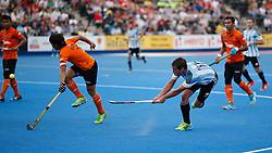 Matias Paredes of Argentina (right) and Sukri Mutalib of Malaysia during the Men's World Hockey League, semi-final match at Lee Valley Hockey Centre, London.