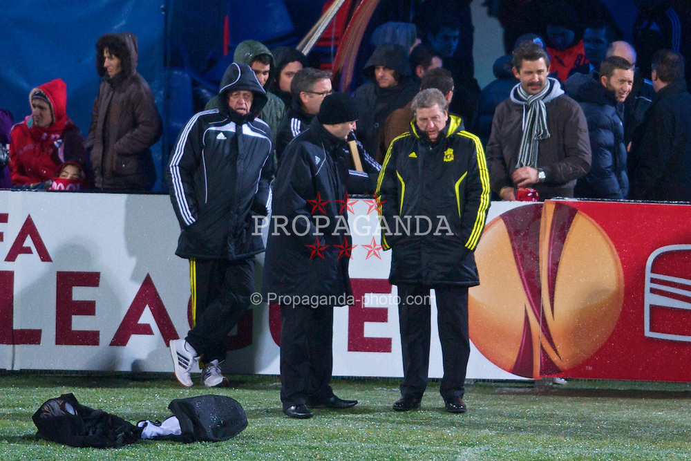 BUCHAREST, ROMANIA - Wednesday, December 1, 2010: Liverpool's manager Roy Hodgson watches his squad training at the Stadionul Steaua ahead of the UEFA Europa League Group K match against FC Steaua Bucuresti. Also head of sports medicine and sports science Doctor Peter Brukner and press officer Ian Cotton. (Pic by: David Rawcliffe/Propaganda)