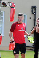 Gareth Bale arrives for the Wales football team training session at the Vale , Hensol near Cardiff,  South Wales on Tuesday 3rd Sept 2013, the team are training ahead of their next FIFA World cup qualifier. pic by Andrew Orchard,  Andrew Orchard sports photography,
