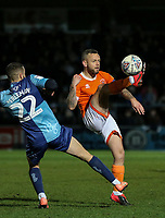 Blackpool's Jay Spearing lobs the ball over Wycombe Wanderers' Nick Freeman<br /> <br /> Photographer Lee Parker/CameraSport<br /> <br /> The EFL Sky Bet League One - Wycombe Wanderers v Blackpool - Tuesday 28th January 2020 - Adams Park - Wycombe<br /> <br /> World Copyright © 2020 CameraSport. All rights reserved. 43 Linden Ave. Countesthorpe. Leicester. England. LE8 5PG - Tel: +44 (0) 116 277 4147 - admin@camerasport.com - www.camerasport.com