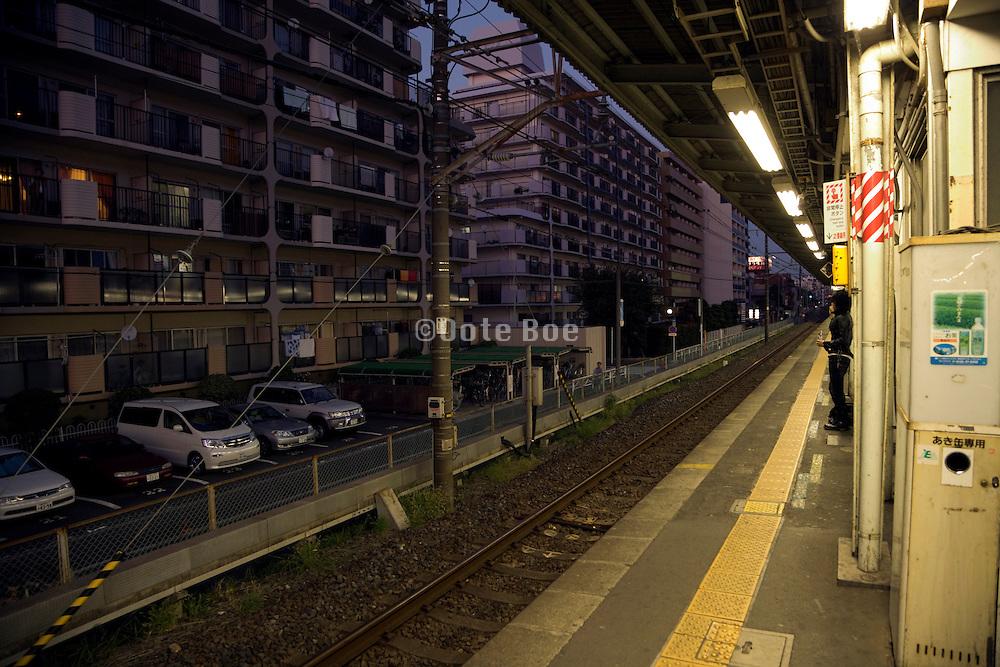 suburban train station near Tokyo Japan