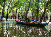 Villagers sell gifts and snacks to tourists on  boat rides through the flooded forest south of Kampong Phluk, Cambodia.