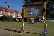 Pennents and bunting on the village green at Horning, a tourist village on the Norfolk Broads.