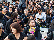 20 OCTOBER 2016 - BANGKOK, THAILAND:  Thais wait to get into the Grand Palace to pay their respects to the late Bhumibol Adulyadej, the King of Thailand. The King died Oct. 13, 2016. He was 88. His death came after a period of failing health. Bhumibol Adulyadej was born in Cambridge, MA, on 5 December 1927. He was the ninth monarch of Thailand from the Chakri Dynasty and is also known as Rama IX. He became King on June 9, 1946 and served as King of Thailand for 70 years, 126 days. He was, at the time of his death, the world's longest-serving head of state and the longest-reigning monarch in Thai history.      PHOTO BY JACK KURTZ