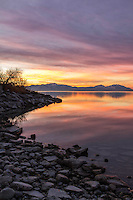 Sunrise illuminates the shores of Utah Lake on a cold Winter morning.